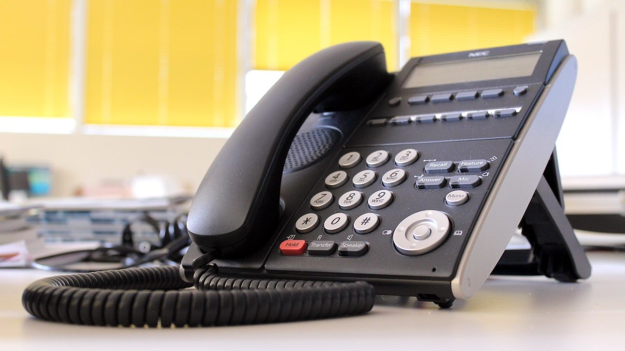 VoIP office phone system on yellow background